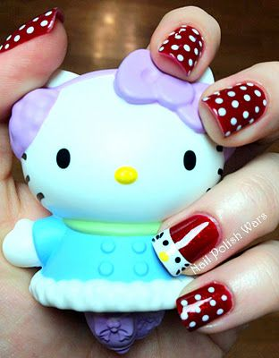 Hello Kitty Nails! Nicole from Polish Wars says she did this by: I started with two coats of Zoya Delilah, a beautiful red glitter in a red jelly base. I used my dotting tool with OPI Alpine Snow to create the traditional Hello Kitty polka dots. I taped off my ring finger and used two coats of Alpine Snow to create the Hello Kitty face. Next, I used the dotting tool with Sally Hansen Mellow Yellow 360 for the nose, and Kiss Black for the eyes. For the whiskers, I used a straight pin with…