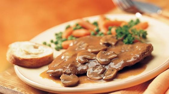 Slow-Cooker Swiss Steak and Gravy Recipe Main Dishes with cube steaks, salt, pepper, onions, sliced mushrooms, condensed golden mushroom soup