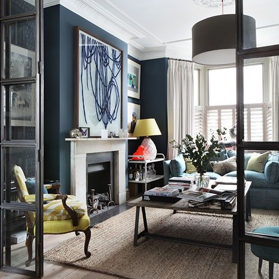 House to Home | Navy Living Room with Large Scale Art, Fireplace, and White Drapes