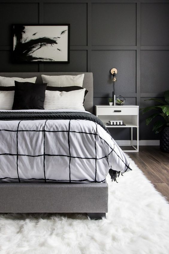 See how we transformed our boring master bedroom into a neutral monochrome modern bedroom with these simple black and white decor ideas! #modernhome #homedecor #oneroomchallenge