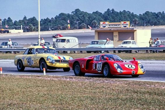 https://flic.kr/p/LEH1F9 | 1968 Daytona 24 Hours | The factory 2-liter V8 Alfa Romeo T33/2 of Mario Casoni, Giampiero Biscaldi and Teodoro Zeccoli leads the 1800 cc 4 cyl. MG B of James Rushin, Thomas Harris and Chris Waldron through turn three (International Horseshoe) at the 1968 Daytona 24.  The Alfa would finish 7th overall but the MG B was a DNF due to a busted clutch.  Eric della Faille photo.