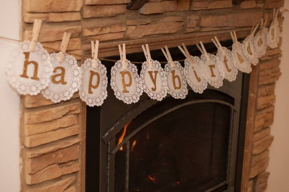 Love the use of paper doilies, clothespins and glitter letters to create a #DIY party banner!
