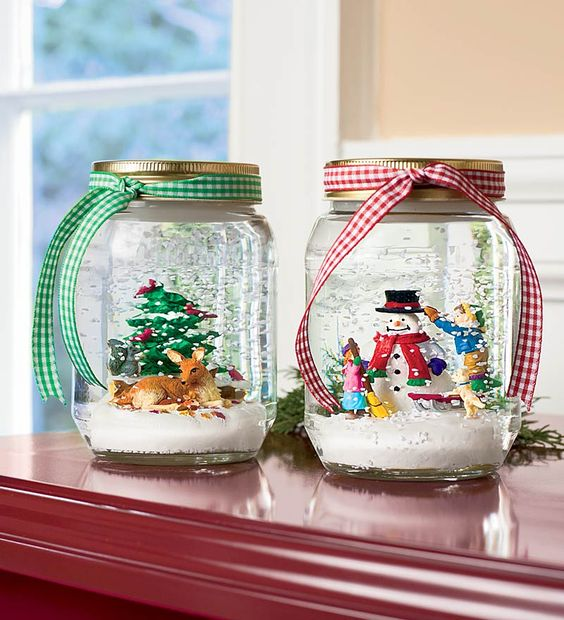 Cute Mason Jar Snowglobes to make for Christmas. One with a reindeer and one with a snowman - all tied up with a gingham ribbon!