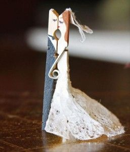 bride & groom made out of clothes pin.