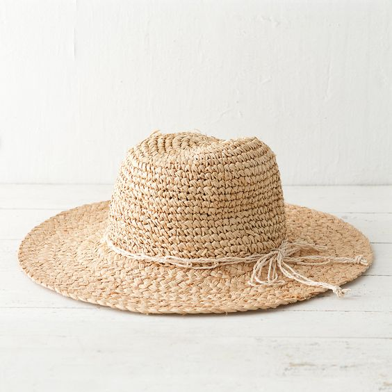 """Tightly woven yet flexible, this natural raffia hat is lightweight and easy to pack for excursions to the shore or errands on sunny days.- Raffia straw- Imported22"""" crown, 3"""" brim"""
