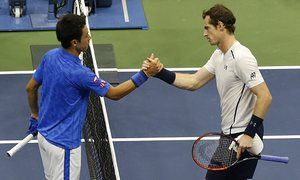 Kei Nishikori shakes hands with Andy Murray afer knocking out the Briton at the…