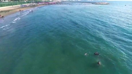 This video released by the Syria Ministry of Tourism shows people swimming and…