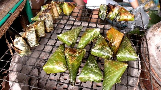 Sticky rice with banana wrapped in banana leaf in Bangkok