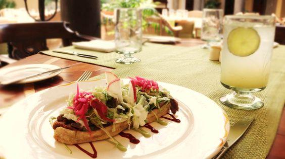"""Huarache de Arrachera: Masa hecha en casa con frijoles y salsa guajillo. Flank Steak """"Huarache"""": Home made dough with beans and guajillo sauce."""