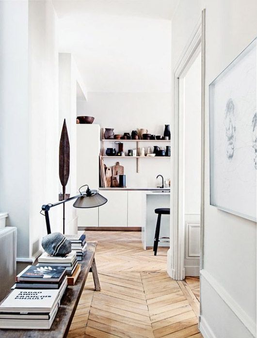 entrance with herringbone wood floors and bench with books / sfgirlbybay