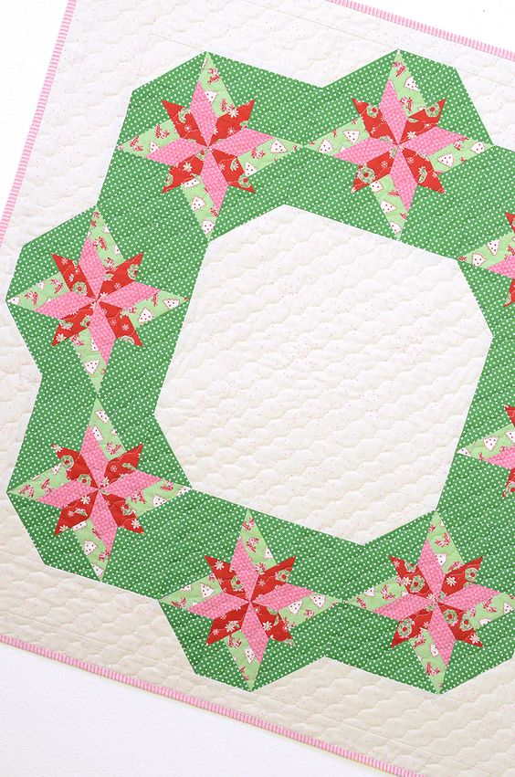 """Decorate your home with a beautiful Christmas wreath wall quilt or table topper. Quilt block size is 9 ½"""" x 9 ½"""", the finished quilt measures 36"""" x 36""""."""