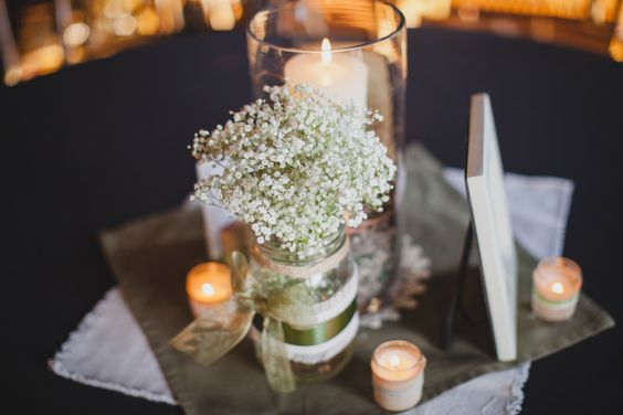 LOVE this mason jar and baby's breath centerpiece! Regina Richards Photography see more on http://www.rusticfolkweddings.com/2014/09/04/rustic-vintage-wedding/