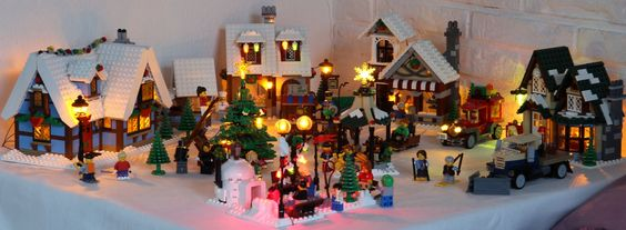 Winter Village with lights.  This is lovely.  Someday I want to do a city scene that is lit up.
