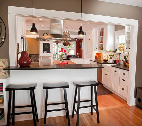 I like the set-up with the kitchen triangle and the colors... more windows please  Wood, Island, Farmhouse, Crown molding, Breakfast Bar, Traditional, Soapstone, European, Flat Panel, Inset, Glass Panel, U-Shaped, Pendant