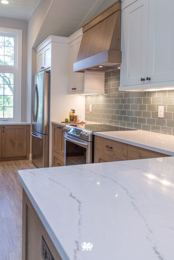 Our Ella quartz countertop is a soothing complement to a beachy and coastal kitchen renovation by @JKathDesignBuil #MyCambria