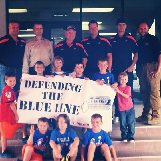 #tbt to Anaheim Ducks head coach Bruce Boudreau, assistant coaches Brad Lauer and Bob Woods and defenseman Luca Sbisa hanging out with the kids from #defendingtheblueline at Marine Corps Air Station Mirarmar in August 2012! #anaheimducksfoundation