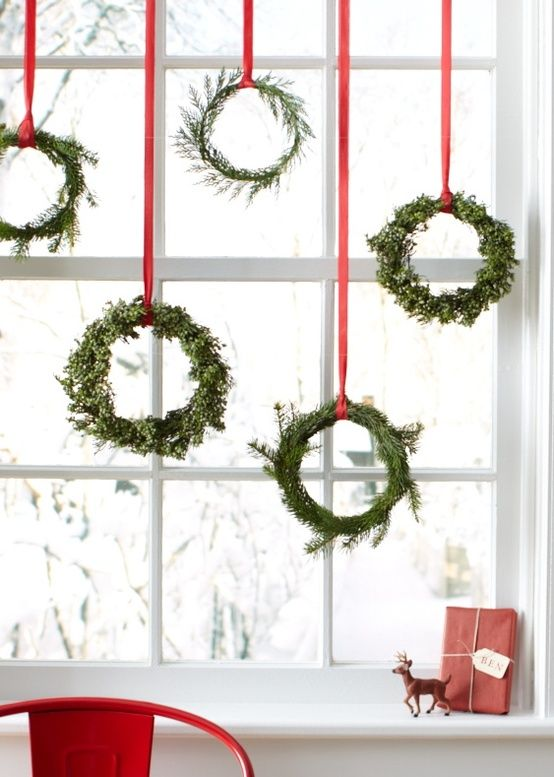 Christmas Decorations: Simple Wreathes Hung from Red Ribbon in the Window | #Christmas #ChristmasDecorations