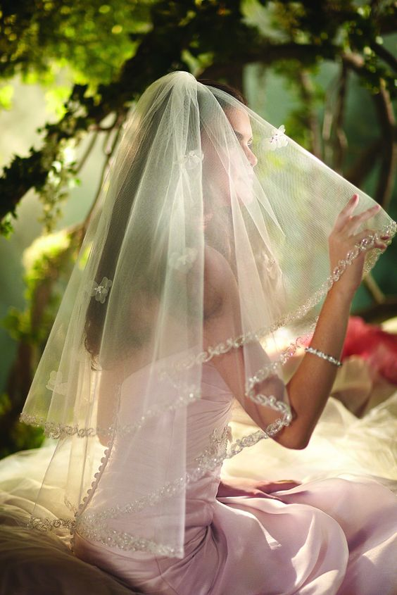"""Sleeping Beauty"" two tier fingertip length veil with organza flowers & beaded embroidered trim by Fairy Tale Weddings from Disney Bridal (Style: 105)."