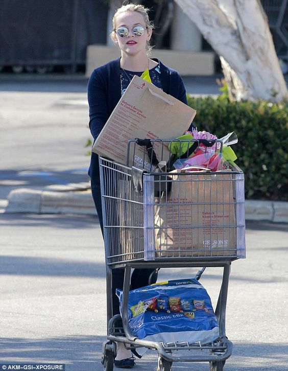 Full cart: The actress pushed a cart full of groceries...: