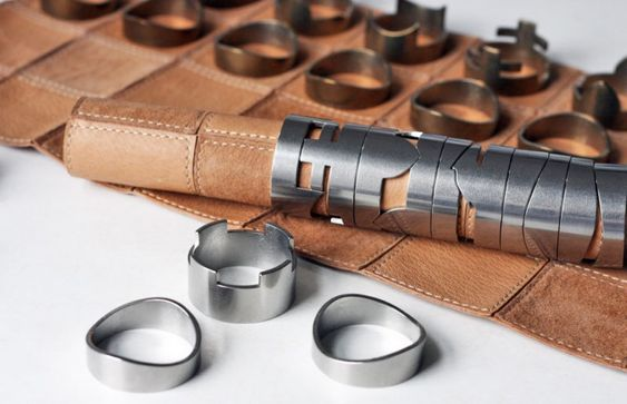 Stackable Chess Pieces Hide a Rolled Up Leather Board Inside