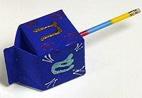 Little gift boxes in the shape of a dreidel
