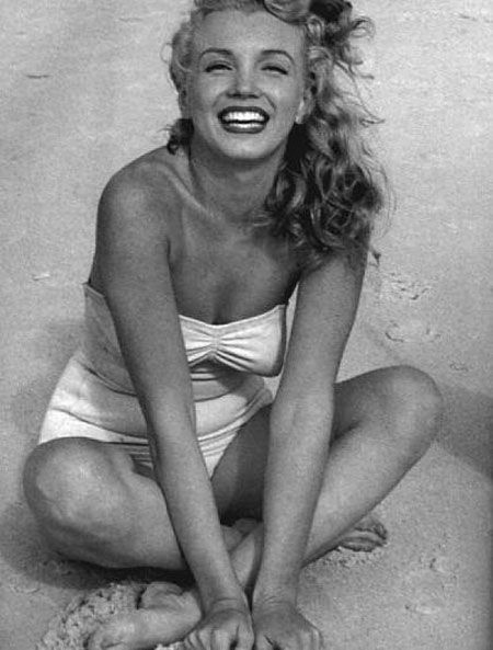 Marilyn Monroe--such a gorgeous, happy picture, and what's that...a tummy roll?! She must be human.