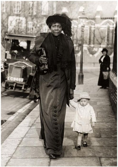 """Mme. Abomah (born 1862?), known as the Amazon Giantess and the African Giantess, traveled the world as the tallest woman -- probably about 6'10"""". Her name was probably Grigsby; she came from Laurence County, South Carolina.  One caption says """"Nanny by Day"""" but something is odd here."""