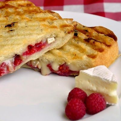 Raspberry Brie Panini - a household favorite.  A perfect lunch but we even chop them up in small pieces and serve them as hors d'ouevres at cocktail parties and they are always a hit. Great with partridgeberries too!