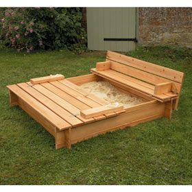 Wooden sand box with lid that folds up to seats
