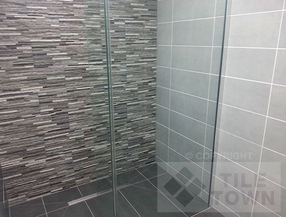 Montana Black Bathroom Wall Tile Montana is a truly innovative range of tiles that uses the latest digital technology to produce a stunning reproduction of real split faced mosaic tiles. Montana is available in two different colours, Black & Beige.