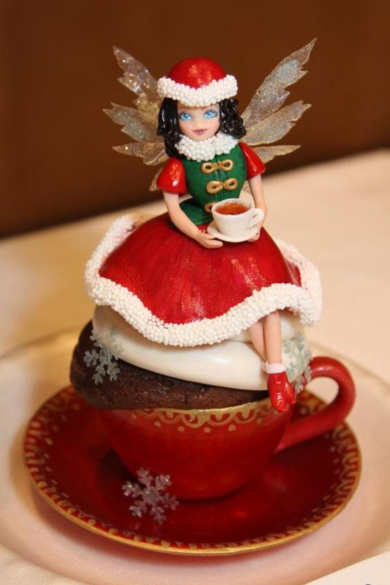 Fairy Teatime! A fairy having her tea on a cupcake! Entirely edible sugar art, created by Larissa.