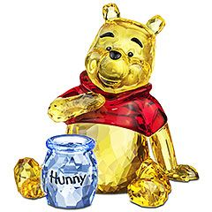 Lovable, cute, and friendly, Winnie the Pooh sparkles in Light Topaz crystal with a vibrant Light Siam crystal shirt. He comes with a Light Sapphire crystal honey pot featuring the word Hunny in black print.  From Swarovski for $230
