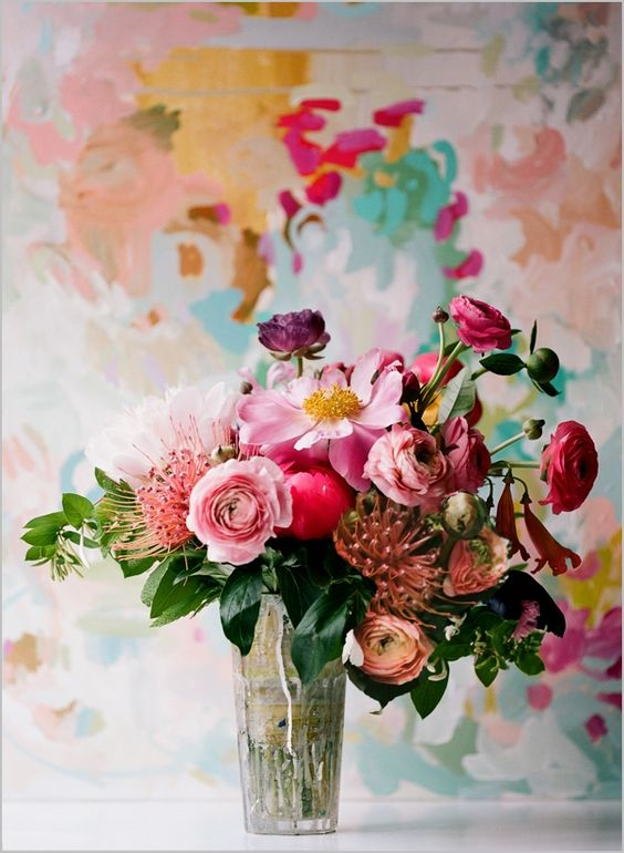 We love this composition of mismatched flowers for a wedding table