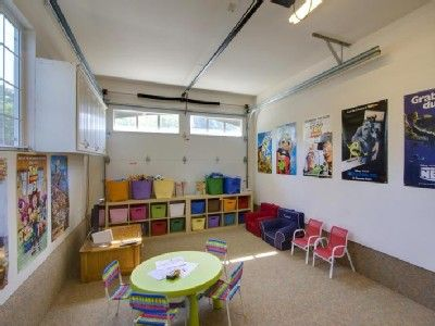 Garage has been converted to a playroom with TV, Wii, mini air hockey, arcade table, and more!