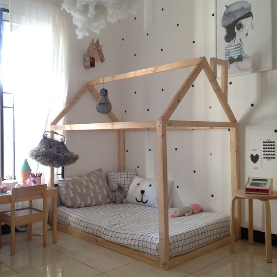 Living a Simple Life in a Tiny House with a Cat - girl's room with house frame bed