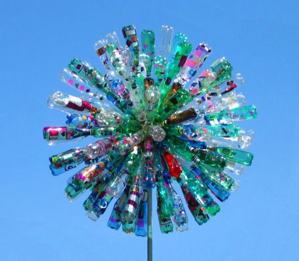 giant dandelions - made from plastic drinks bottles, cut so they move in the wind