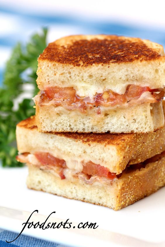 Garlic rubbed grilled cheese with bacon & tomatoes. Heavenly.