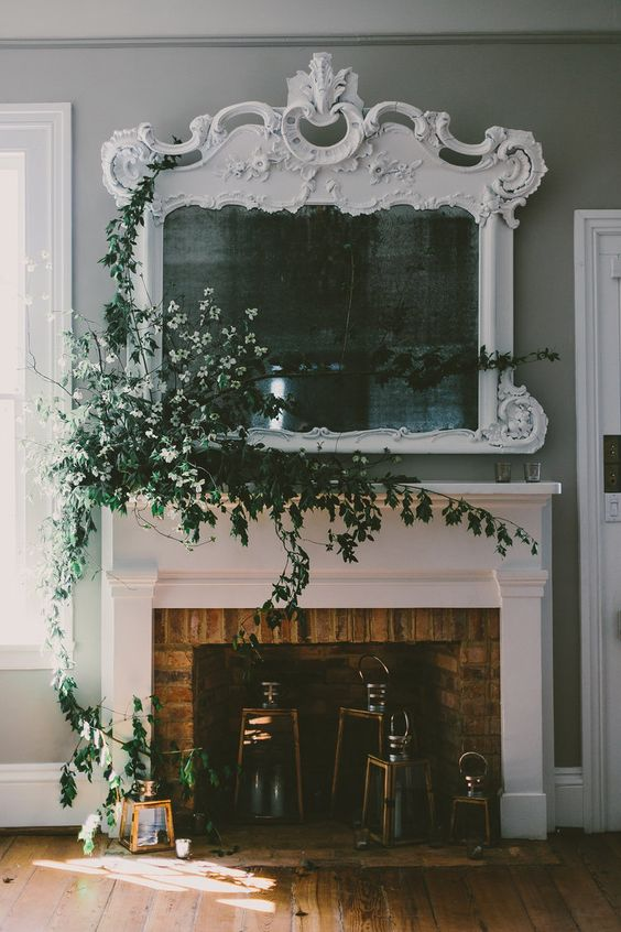The power of branches and vines, once more. While we wouldn't need an installation this large, I cannot overstate the potential of foliage to uplift any centerpiece or design, large or small. Subtle, powerful, and dramatic.