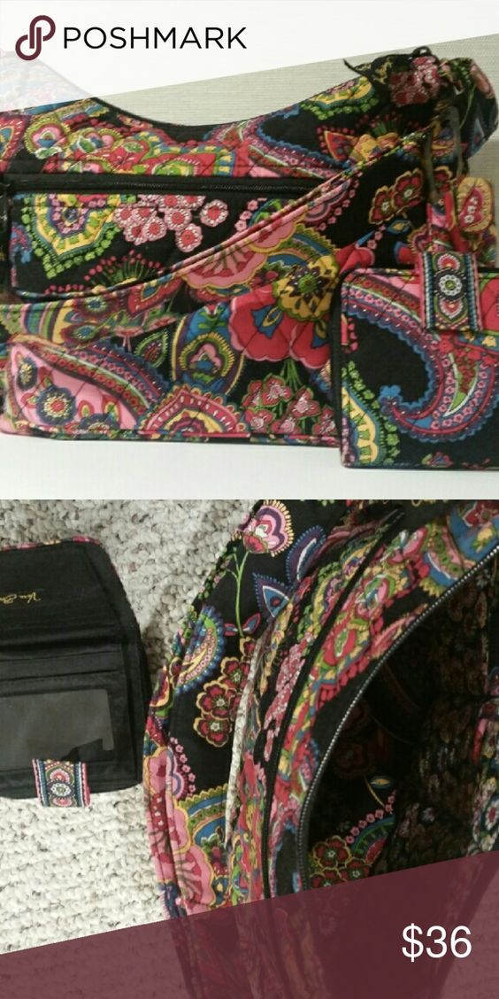 Vintage Vera Bradley Hobo Bag Barely used bright colors with black background vintage hobo bag. Adjustable shoulder strap. Zippered compartment on front and pockets inside. Little pockets on either end of outside of bag for phone and keys. Comes with matching billfold wallet with room for license and credit cards and a zippered space for coins. Vera Bradley Bags Hobos