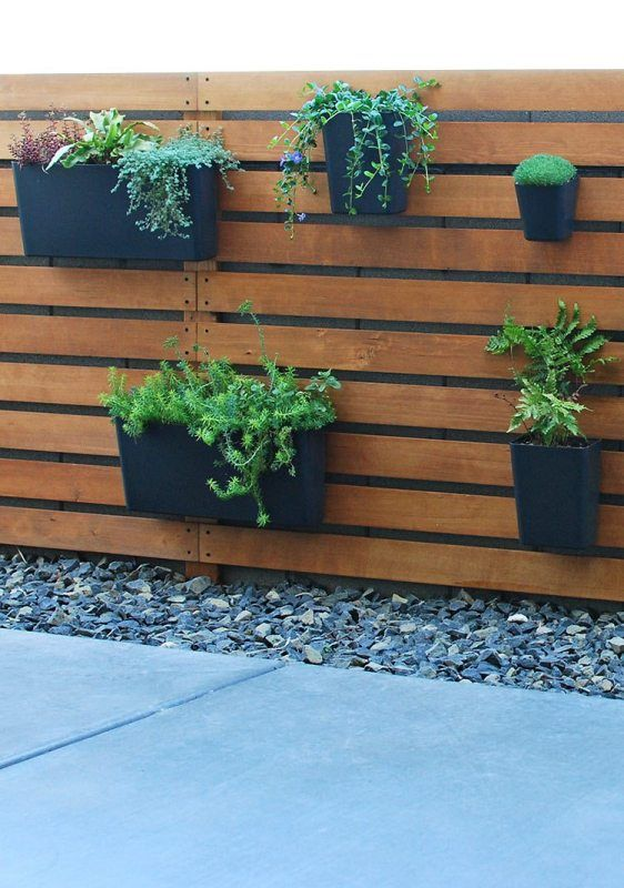 Diy Wood Slat Planter Wall Over Concrete Block Fence The Garden Glove Featured On Remodelaholic Garden Wall Designs Garden Wall Outdoor Wall Decor