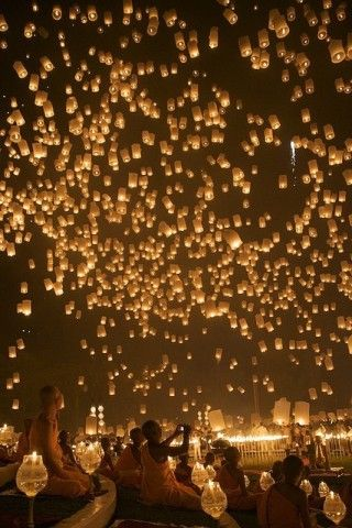 Releasing paper lanterns at the end of a wedding. Way cool! I want someone to do this at a wedding of mine.