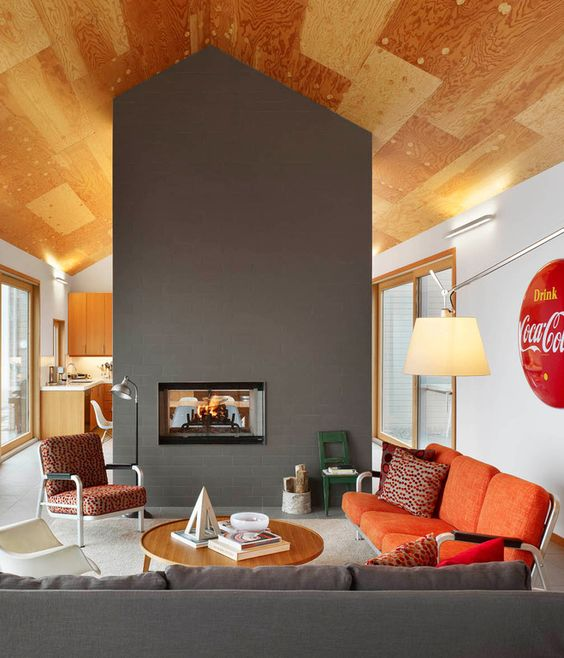 Though technically all one space, the living room, dining room, and kitchen are separated by the double-sided fireplace. When the couple ...