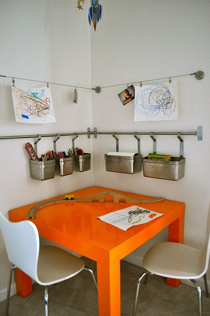 Simple way to add a creative corner without sacrificing a lot of space. Love this for kid's playroom