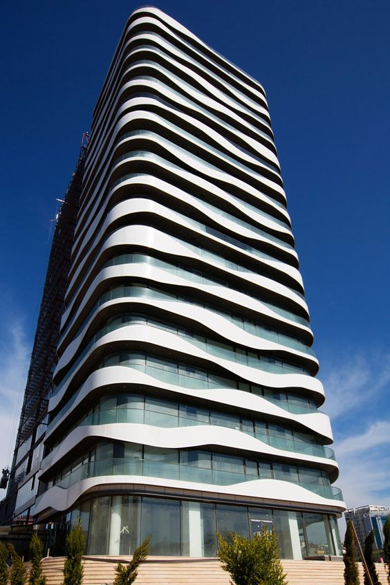 Wavy balconies surround a new office building in istanbul for Balcony surrounds