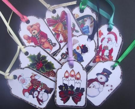 """Christmas tags gold on Craftsuprint designed by Carol Dunne - made by Hilda Mullinger - These beautiful tags I printed on glossy photo paper and cut out. I punched a hole into each one and added various coloured ribbons of approximately 7"""" (17 cm) to each one. - Now available for download!"""