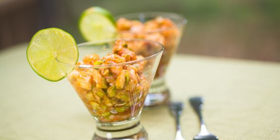 "Ceviche de Camaron: Shrimp Ceviche ""Cocktail"" made with traditional flavors of red onion, lime juice and cilantro with orange juice added for a refreshing citrus flavor"