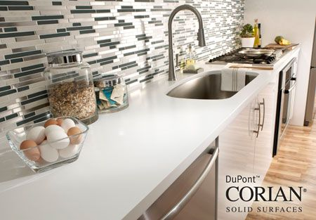 White Corian countertop,. Clean and bright..just right for a subway tile backsplash.