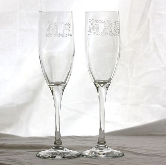 Mr & Mrs Champagne Flutes for wedding table setting. Hand etched his and her champagne glasses, special engagement gift. $40.00, via Etsy.