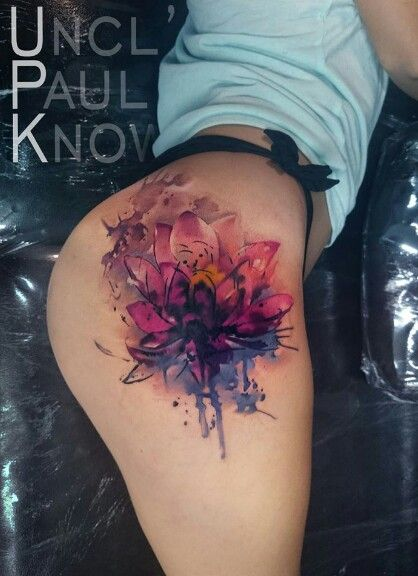 Watercolor thigh tattoo