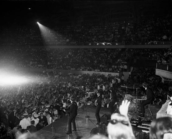 Chicago History in Pictures, The Beatles playing a concert at the International...